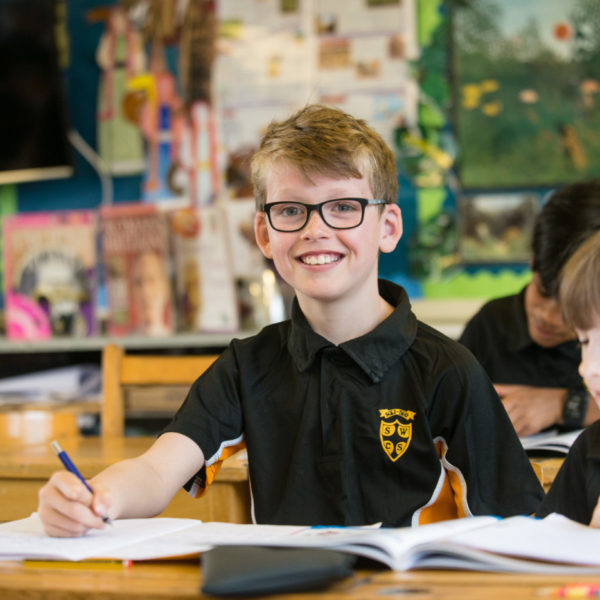 Boy smiling in class
