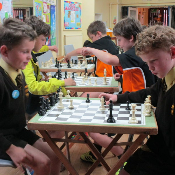 Boys playing chess – chess club