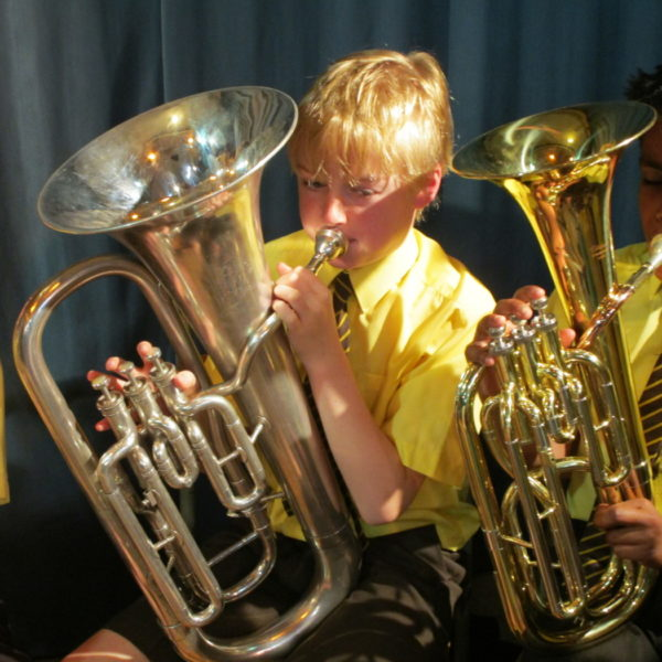 Boy playing brass